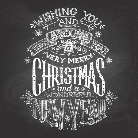 Vintage hand-lettering Christmas and New Year wishes with chalk on blackboard background, greeting card