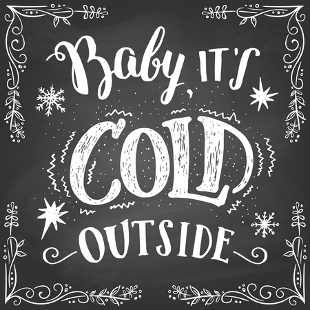 it's: Baby its cold outside. Christmas romantic typography. Chalkboard hand-lettering sign. Greeting lettering and hand drawn frame on blackboard background with chalk