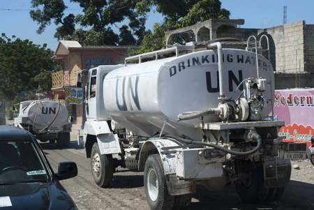au: Unitaed Nations UN water trucks in Port au Prince, haiti Editorial