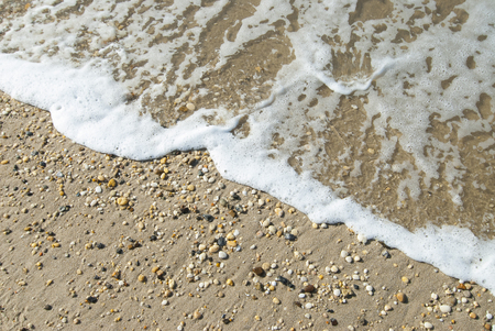 hatteras: Gentle ocean wave washing across pebble beach at Cape Hatteras National Seashore, North Carolina