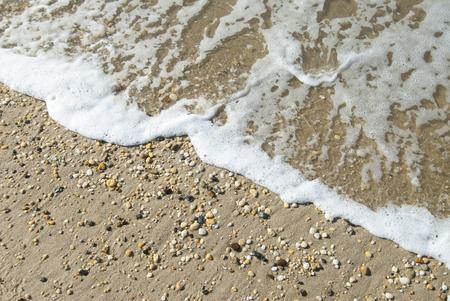 seashores: Gentle ocean wave washing across pebble beach at Cape Hatteras National Seashore, North Carolina