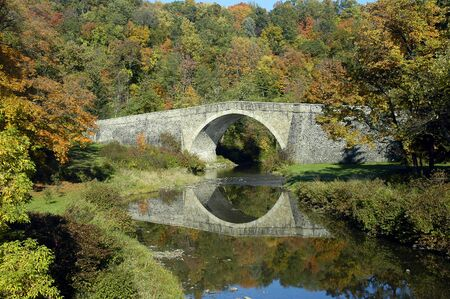 Historic Casselman River Bridge on old National Road in Grantsville, Maryland with fall colors