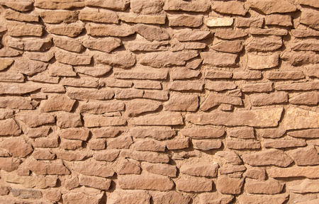 adobe wall: Ancient sandstone adobe wall pattern from ruin at Wupatki National Monument Stock Photo