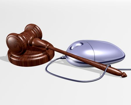 An illustration of a gavel resting near a computer mouse representing Internet auctions. Stock Photo