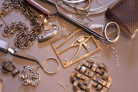 jeweler: Close up of work in progress on a silversmiths bench. Stock Photo