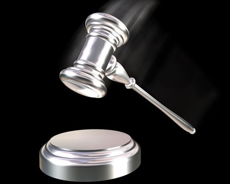 auction win: A silver coloured gavel striking down on a block