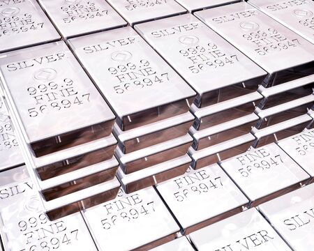 stacks of pure silver bars on piles of bullion photo