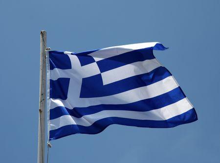 flagpoles: Greek flag flying in a warm Mediterranean breeze Stock Photo