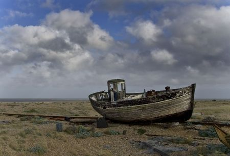 wrecked: Broken down old fishing boat marooned on a beach