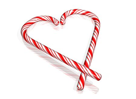 Two candy canes resting on each other to form a loving heart photo