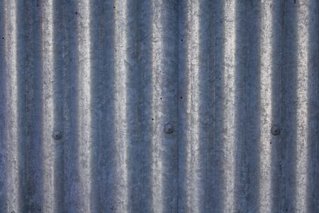 Galvanized and corrugated sheet steel structure with rivets photo
