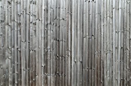 bleached: Knotted wooden fence weathered and sun bleached  Stock Photo