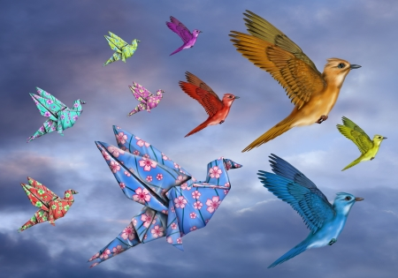 Origami and stylized birds flying across the sky photo