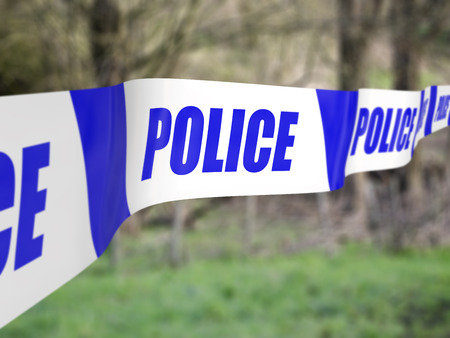 police tape: Police tape used to cordon off an incident Stock Photo