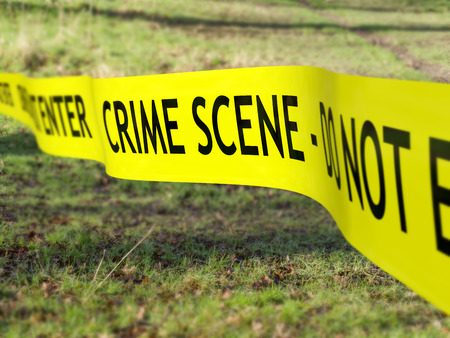 police tape: Crime scene tape being used to protect a criminal investigation