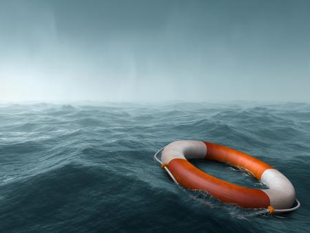 海の広大に浮かんでいる救命浮輪 写真素材