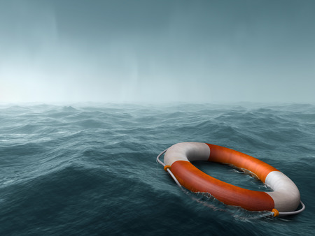 Lifebuoy floating in the vast expanse of sea Stock Photo