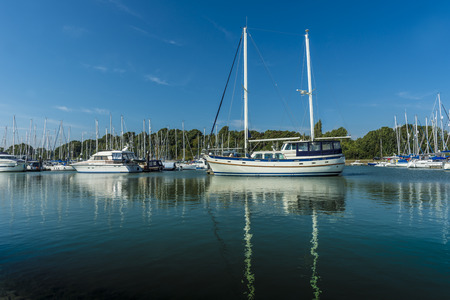 harbour: Yachts moored in a sunny tranquil marina