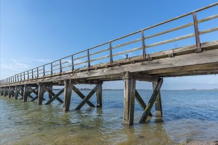 seafronts: Old weathered wooden jetty on the seafront