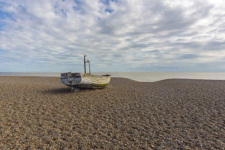 shingle beach: Fishing boat sitting on a shingle beach