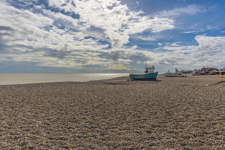 beach shingle: Fishing boat sitting on a shingle beach