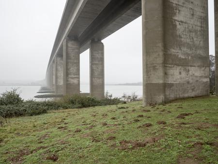 suffolk: Imposing bridge spanning a calm misty waterway