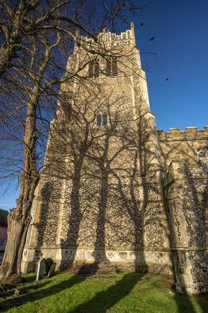 church tower: Imposing church tower with stark tree shadows