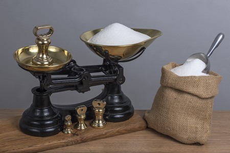 Using antique cast iron and brass scales to weigh sugar