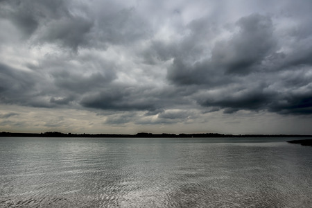 reflective: Highly reflective water on a cloudy morning Stock Photo