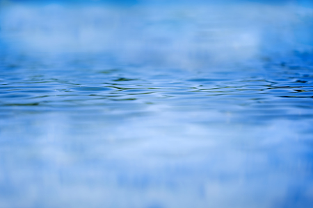 shallow  focus: Shallow focus looking across blue water with ripples Stock Photo