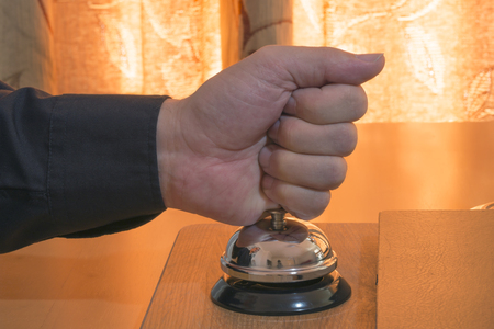 demanding: Hotel guest thumping down on a hotel bell