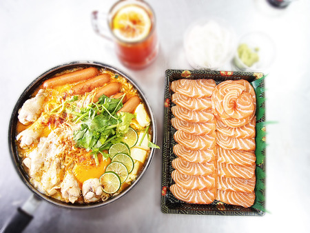 noodle in spicy milk curry soup and salmon with blur background