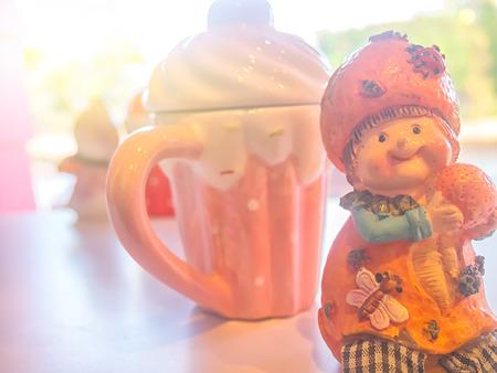 ceramic doll on table with sun light.