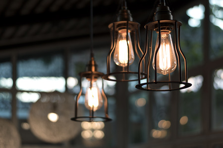 beautiful Light bulb incandescent hanging decorated interior room,selective focus.