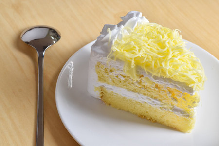 piece of cake with whip cream and grated cheese topping,selective focus. Stock Photo
