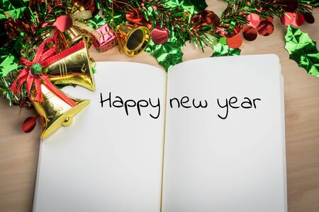 five to twelve: happy new year word on notebook with new year decoration for new year holiday.