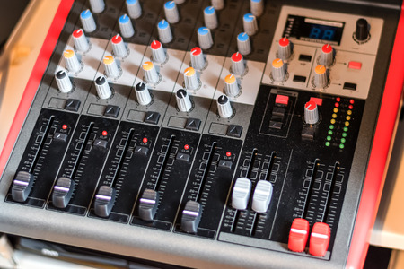 close up electronic professional sound mixer control panel in music studio with channel console and media button for record music or live radio,selective focus.
