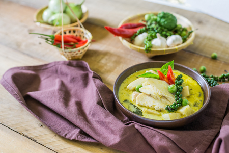 favorite soup: spicy hot chicken green curry with coconut milk soup in bowl,thai food,selective focus. Stock Photo