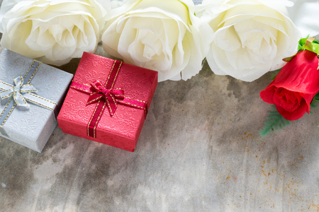 dinne: Love concept valentines day background,red heart with red white rose ,ribbon and present box decoration,selective focus