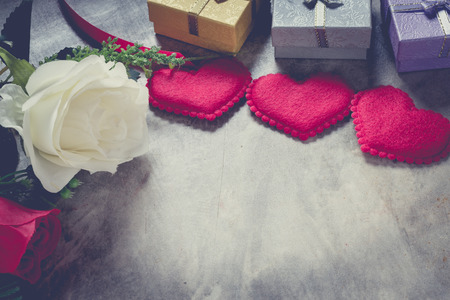 dinne: Love concept valentines day background,red heart with red white rose ,ribbon and present box decoration,selective focus,vintage filter. Stock Photo