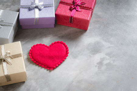 valentines day background,red heart with red white rose ,ribbon and present box decoration,selective focus. Stock Photo