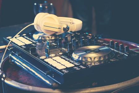 party concept : dj player electric turntable hip hop mixer headset nightclub concert ,selective focus Stock Photo
