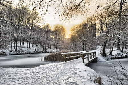 Winter landscape with a wooden bridge photo