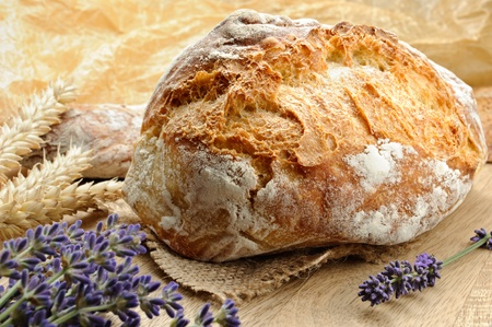Close-up on traditional bread with lavender flowers  photo