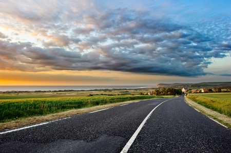 Sunset landscape with coastal road  photo