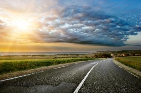 coastal city: Sunset landscape with coastal road