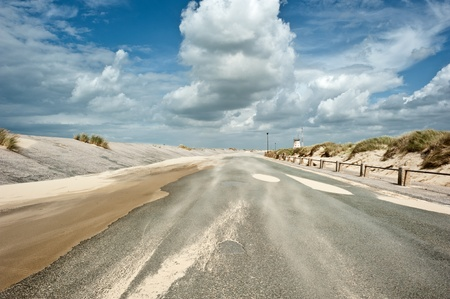 Windy coastal road on a sunny day with light clouds  photo