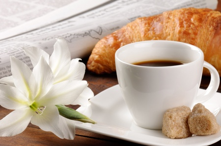 Breakfast with newspaper, croissant and coffee  photo
