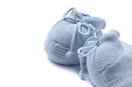 booties: Blue baby booties isolated over white background with copyspace