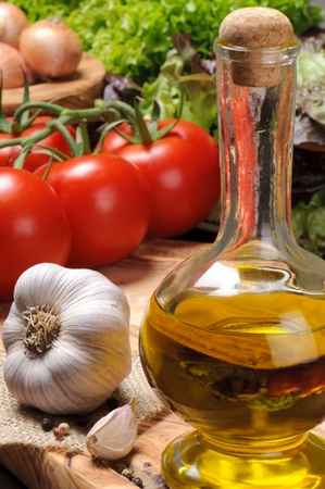 Set of fresh vegetables with olive oil photo